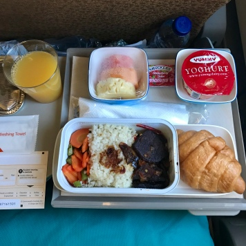 Orange Juice, Fruit, Yoghurt, Beef rice, and Croissant. Breakfast on the plane wasn't bad at all