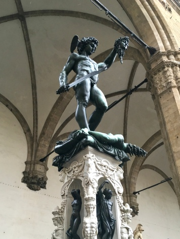 My favorite statue in Piazza della Signoria is that of Perseus with the head of Medusa. This statue was created by Benvenuto Cellini in 1545, but unlike the other statues, this one was created from bronze, not marble