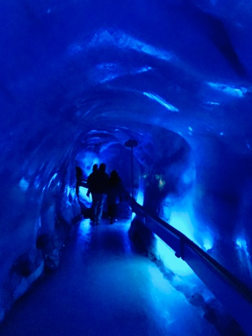 An ice cave where you can walk through a tunnel with the walls of the cave being made of ice