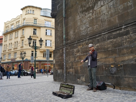 I was walking down the street when i saw street Violin performer. He was playing beautifully, and i gave him all my coins