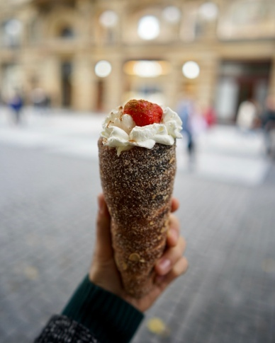 Chimney donut be like. The most Instagrammed pastry from Prague. You can choose different flavours inside such as strawberry and whipped cream, nutella or melted chocolate, vanilla ice cream, etc