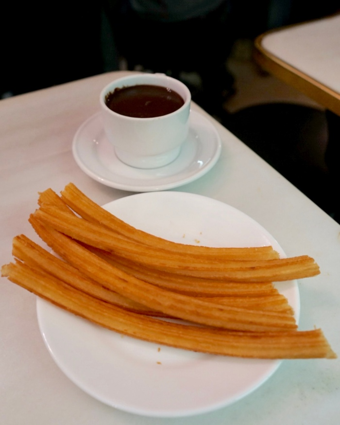 Porras! Spain's most famous breakfast. The golden fried dough sticks coated in sugar, served with a cup of thick and rich chocolate