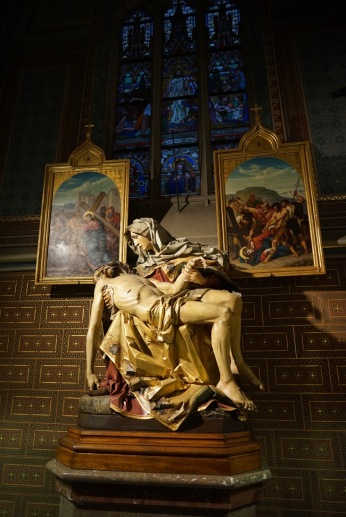 The stained glass windows and statues are explaining the suffering and glorification of Christ