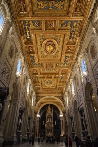 The enormous marble-clad interior owes much of its present look to Francesco Borromini, who redecorated it for the 1650 Jubilee. It's a breathtaking sight with a golden gilt ceiling, a 15th-century mosaic floor, and a wide central nave lined with 18th-century sculptures of the apostles and set in its own dramatic niche